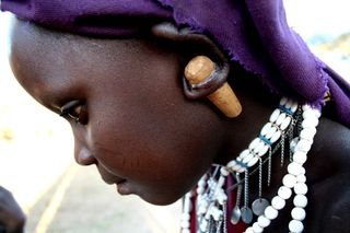 Girl with ear plug